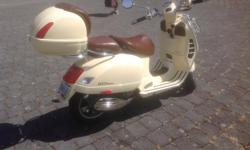 LIKE NEW - LOW MILEAGE (approx. 26,800 miles) -278cc Touring Scooter in Sienna Ivory. Max speed 129 km/hr. Automatic transmission. Many Extras : Vespa Tour Pack, Vespa Bag/Backrest, Side Stand, Brown dash panels with 12v receptacle, Sienna Ivory touch-up