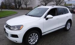 Make Volkswagen Model Touareg Year 2013 Colour White kms 70977 Trans Automatic Stock #: BC0030719 VIN: WVGEF9BP9DD000043 2013 Volkswagen Touareg VR6, 3.6L, 6 cylinder, 4 door, automatic, 4WD, 4-Wheel ABS, cruise control, CD player, navigation, power door