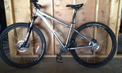 2014 Kona Mahuna mountain bike. Size 19 (large) frame. Good condition, only selling because I moved up to a full suspension model. All routine maintenance work done at Rock City Cycles. Just serviced and had disc brakes replaced to ready for resale.