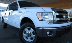 Make Ford Model F-150 Year 2014 Colour White kms 122627 Trans Automatic Price: $25,297 Stock Number: PM1807A VIN: 1FTFW1EF4EFB90580 Interior Colour: Grey Engine: 5.0L V8 Bluetooth, Trailer Tow Package, Power Windows! This 2014 Ford F-150 is white in