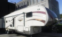 Stock #: BC0030337 VIN: 1NL1YFT2XE1075720 2014 Gulf Stream Canyon Trail by Seahawk Fifth Wheel Travel Trailer with 4 Slide Outs and Bunks. 2 doors, sleeps 7, awning, fridge, freezer, 2 toilets, shower, double sink, 2 tv's, washer/dryer, microwave, 3