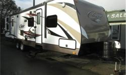 Price: $31,900 double slide bunk trailer , cougar 31 foot , two t v s electric awning , electric front jack , out door kitchen