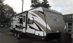 Price: $27,900 26 foot cougar trailer , front queen bed , rear double bunks , rear bathroom , two doors , slide out , winter pack with dual pane windows
