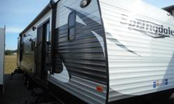 This spacious Springdale travel trailer 38FL offers many of the comforts of home featuring a front living area including a fireplace, dual slides for added interior space, and dual entry doors. Special Features: As you step through the glass patio doors