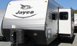 This beautiful, barely-used, 2016 Jayco Jay Flight trailer will impress you from the moment you walk in the door. - 2 slide-outs creating a wide-open living space. - Island in the kitchen (featuring double sink with cover & high-rise residential faucet),