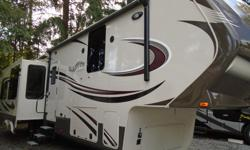 Arbutus RV Price $99,782 Year-end Liquidation Savings NOW $94,495 EXTRAORDINARY! The Grand Design Solitude 369RL could be the finest fifth wheel rear-living space ever designed and produced - spacious and perfect for entertaining. With TRIPLE slides, the