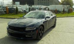 Make Dodge Model Charger Year 2017 Colour Blue kms 40806 Trans Automatic Stock #: BC0030331 VIN: 2C3CDXHG8HH654011 2017 Dodge Charger SXT, 3.6L, 4 door, automatic, RWD, 4-Wheel AB, cruise control, air conditioning, AM/FM radio, power door locks, power