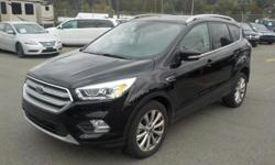 Make Ford Year 2017 Colour Black Trans Automatic kms 53900 Stock #: BC0030379 VIN: 1FMCU9J94HUD88014 2017 Ford Escape Ecoboost Titanium 4WD, 2.0L, 4 cylinder, 4 door, automatic, 4WD, 4-Wheel ABS, cruise control, air conditioning, AM/FM radio, CD player,