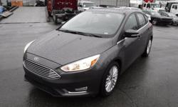 Make Ford Model Focus Year 2018 Colour Grey kms 23295 Stock #: BC0030849 VIN: 1FADP3N28JL296450 2018 Ford Focus Titanium Hatchback, 2.0L, 4 cylinder, 4 door, automatic (tiptronic), FWD, 4-Wheel ABS, cruise control, air conditioning, AM/FM radio, CD