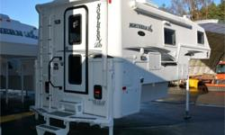 Price: $63,950 Stock Number: 990617-4337 VIN: NL10-2EXCD96719LE Northern Lite Limited Edition 10-2EX Wet Bath truck camper highlights: Overhead Cabinets External Speakers Microwave Queen Bed   When you're ready to escape the hustle and bustle of