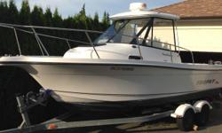 2003 Trophy Pro Hardtop 2052 model. 4.3 litre mercruiser with freshwater cooling and alpha 1 drive. Includes tandem Karavan trailer with updated disk brakes, lowrance elite 7 sounder with charts, radar, wash down, bait well, vhf with distress attached to