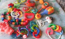 20 infant rattles, etc, all in very good clean condition, three play music,, and a crib/stroller mobile