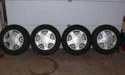 4 COOPER CS4 TOURING all season radials mounted on 2000 GM CHEV MALIBU ALUMINUM RIMS, bolt pattern: 5 X 115mm high positive offset, Only summer driven, less than 30,000 KLMS on tires. $350 O.B.O. Call Brian, days 905-641-4215 or evenings 905-382-4631.