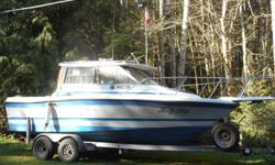 1988, 21 ft. Bayliner, Tropphy class with cabin, comes with head, radios, fishfinder and chart plotter, gal. trailer. 4cy, 3 l. inboard with 20 hp merc kicker.
