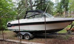 21-foot Reinell power boat and Highliner tandem trailer. The boat was built in 1974 and was significantly refurbished in 2000. Both boat and trailer have been out of the water and under cover outside for several years. Both are weathered and will need
