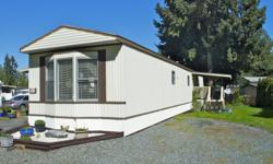 # Bath 1 Sq Ft 980 # Bed 2 Beautifully well maintained home, with a large yard. This bright mobile offers an open concept with a large kitchen & living area, with vaulted ceilings and lots of natural light. Some of the upgrades include new countertops and