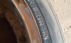 265/35 r22 's on badly oxidizing rims. Look cool and bad at the same time. I think they came off a bmw SUV.