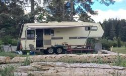 91' kustom koach 5th wheel, very clean for the year, tons of storage, everything works great, 2-30lb propane tanks, brand new batteries last year, there was a couple leaks but they have been dealt with, floors are all completely solid, out door shower,