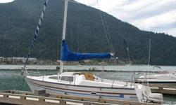 For sale is a 1984 Lancer PS27 sailboat. She is moored on Harrison Lake, in a well secured Marina with a transferable slip. It's a fiberglass hull and has a 90 horsepower motor that needs a bit of work. It runs well but is not pumping water at the