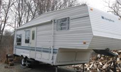 Reduced!!This trailer is a must see. In excellent shape. The floor is solid and NO leaks. The bedroom has a walk around queen size bed with storage under it. Trailer sleeps 6. Has stove, oven, large 2 way fridge and freezer, 2 way hot water heater,