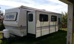 1998 28 ft Wanderer travel trailer. In great condition. Queen bed, full bath, large kitchen, pop out living room-dining room. Heat and air conditioning.