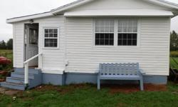 # Bath 1 Sq Ft 972 # Bed 2 Twenty-seven miles from Charlottetown in Dromore, Mount Stewart; 2 bedroom, one bath, laundry room, large kitchen and livingroom with small porch. New laminate floors and tiled bathroom. Kitchen cupboards are maple with white