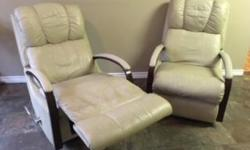 Extremely comfortable recliners. Neutral beige (mushroom) colour. Normal wear. Sold as a set ($500 total.)