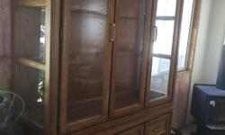 Beautiful shape china cabinet. 2 pieces. Glass shelves come out along with the ones in the frame. 2 shelves below with a drawer.