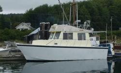 33' Aluminum Hull Trawler Style Diesel Powered Suitable for Live-aboard - ISUZU DA120 Diesel Engine - 200 Gallon Fuel Tank - 100 Gallon Freshwater - Sleeping for 4 + - Head c/w Shower - U Shaped Galley c/w Propane Stove with Oven - Freezer with 1500 Watt
