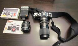 Great deal on a 35mm Pentax camera with regular lens and telephoto lens, willing to trade or take first 75.00