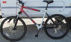 "Fire Mountain mountain bike in mint condition with rock shox, disk brakes. 20"" frame . This bike is a perfect fit for a teen and up. Sacrifice for $395. 2502020110."