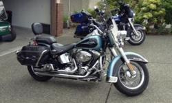 IMMACULATE, IMMACULATE!!! LOW MILEAGE ONLY 26,167 km. Very unique color combination of Suede blue/black. Backrest, custom passenger pillion, Luggage rack, Leather Bags well maintained and oiled . Saddle bag guards and crash bar with highway pegs. 96 Cubic