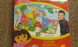 """Each puzzle is in good condition and has only been pieced together a handful of times.   1 - Dora the Explorer Map of Canada puzzle - 46 pieces   2 - Giant Floor Puzzle """"Find it! Friends"""" - 50 puzzle pieces + 25 game pieces   3 - Giant Floor Puzzle """"Giant"""