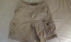 3 pairs of Men's Cargo shorts with matching canvas belts. No holes or rips on any of them, just usual signs of wear. Old Navy Size 29 Men's Light Tan Cargo Shorts in good condition with bonus tan canvas belt for $10. Old Navy Size 30 Men's Dark Blue Cargo