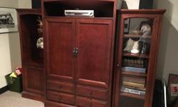 Solid wood Canadian made entertainment unit. Can be used separate or together great shape.