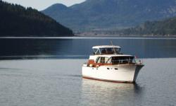 40'Chris Craft Conqueror with 23'x60' custom boathouse Twin 283 Fuel Capacity 200 gal Fresh Water 50 gal Kohler generator Sleeps 8 Two heads Full L-shaped Galley HST included in price