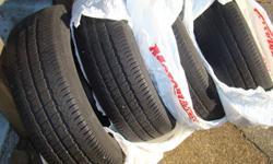 4 Bridgestone Insignia Tires taken off my 1999 Caravan.    P205/75R14 95S  M&S   2 in excellent shape  2 in good shape.   No rims