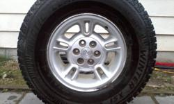 4 Factory Rims for Dodge Dakota off a 2000 Dodge Dakota They currently have Arctic Claw Winter tires on them! The 2 front have almost no tread left, the 2 rear have lots of tread left. We're not selling the rubber, it's yours FREE with purchase of the