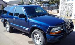"""Make Chevrolet Model Blazer Year 2005 Colour Blue kms 112000 Trans Automatic Air, cruise, seat heaters, remote starter, new winter tires on original wheels, """"like new"""" summer radial tires on after market wheels (see photo). Extremely low kilometers."""