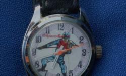 Superman Wristwatch that is wonderful working order.............with original leather strap. Swiss made, mechanical wind-up. This specific model is a hard to find model........can arrange shipping at cost  to usa + canada. send zip code or postal code for