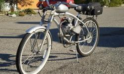 49cc 4-stroke motorized bicycle...Cost over $700.00 in various parts and materials (machining,bike etc...) ,120 mpg,25-30 mph,comes with brand new never used 49cc spare engine.This thing is a hoot and quite the conversation peice.perfect for puttin'
