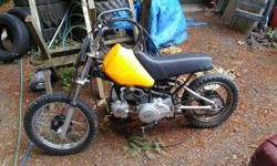 Runs but needs carb cleaned (slow jet clogged) rear tire is fairley bald great little starter bike though make an offer time for son to move up