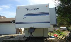 !999 26ft Terry Northwest Edition. 2 pull-outs. Living room and bedroom. New 10 ply tires. Comes with 5th wheel hitch and front hitch stabilizer. Please call phone # listed after 6:PM for more info.