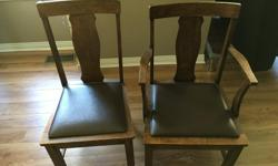 1 solid oak captain chair and 5 plain chairs. Need a little TLC to restore to former beauty.