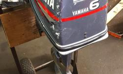 6hp Yamaha Outboard Motor -2 stoke -short shaft -pull start -tiller handle -comes with tank and hose -runs well