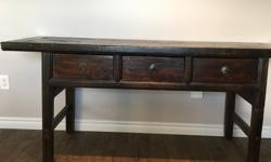 We have a reclaimed wood console table from Jordans Home Store for sale. I bought it for 1300 + tax new, less than a year ago, but I'm willing to let it go for $700! Make me an offer :) I love this table! I've gotten tonnes of compliments on it, but we're