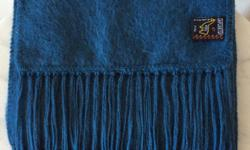 78 INCH LONG 100% ALPACA SCARF BY CAPCHATEX FROM PERU, FRENCH BLUE COLOUR AS SHOWN, MEASURES 9 INCHES WIDE, UNISEX - WOULD SUIT LADIES, MENS, OR TEENS, HARDLY USED - IN PERFECT CONDITION.