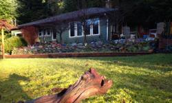 # Bath 1 # Bed 3 Gorgeous house in Youbou at Lake Cowichan on Vancouver Island ... beautifully landscaped tiered property with mature fruit trees and garden beds ... apple, plum, cherry, pear trees .... strawberries, grapes and raspberries ... walking