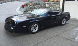 Make Chevrolet Model Camaro Year 1988 Colour Black Trans Automatic Best looking CONVERTABLE 88 IROC on the island. black on black on black. Pictures tell to all, 305 carb motor automatic. Good clean tires clean wheels clean car .. No dealers no other pal