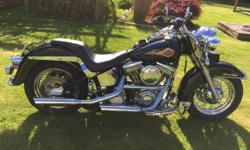 Looking to buy a Harley without breaking the bank? 1996 Heritage Softail, $7995 OBO. 100 RevTech motor and 6 speed Ultima trans with less than 6KM's. Lots of HD chrome, paint is in great shape, super fast, runs great. Bought a new bike, so this one needs